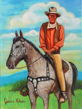 John Wayne is seated on a horse an appleloosa, dappled grey and white with a decorative saddle. John Wayne  is wearing a coral peach colored shirt with vest and camel pants.