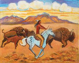 Indian buffalo hunter is riding his pony along side the buffalo charging along the prarrie.