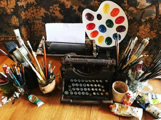 Typewriter and art supplies